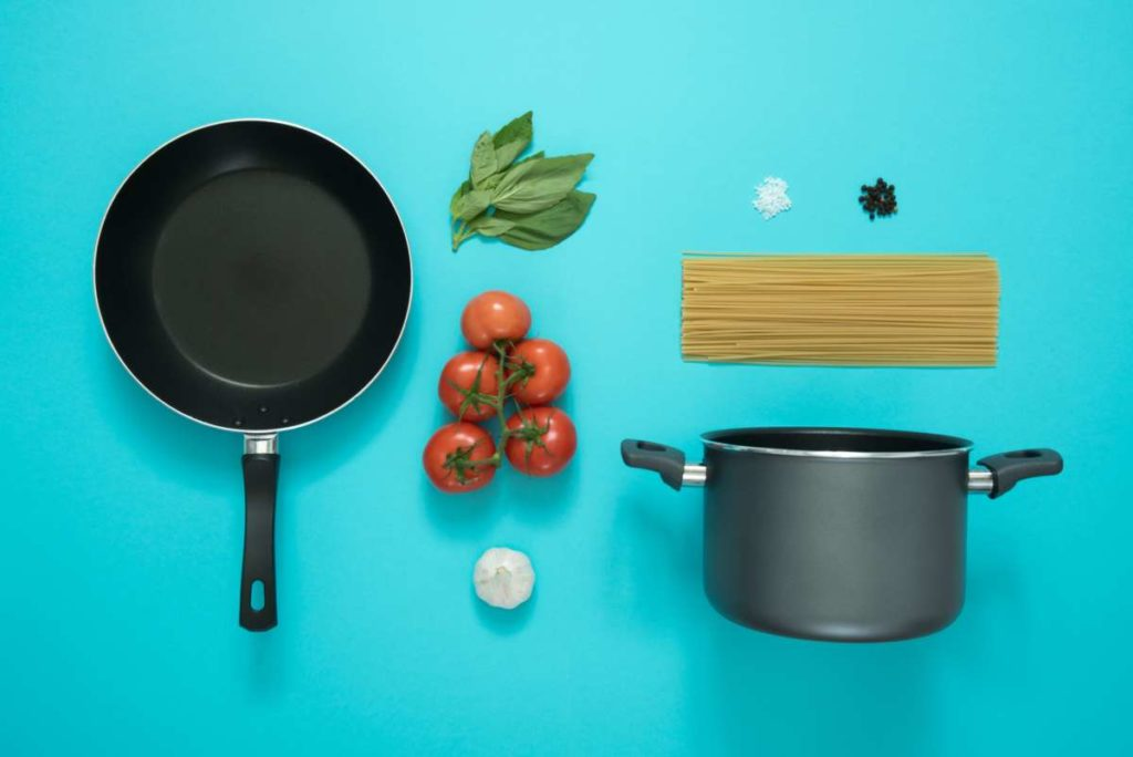 Black And Gray Cooking Pot And Frying Pan With Tomatoes 877226